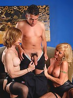 Two horny shemales having fun with a dude