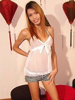 Baby faced Aum is soon out of her cut-off shorts and showing off her long cock