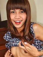 Slim ladyboy with dick sucking lips strips naked and shows off her rock hard cock