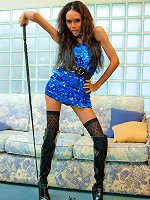 Shemale domina in thigh high boots and a mini gown