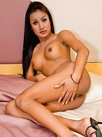 Shemale stunner Noung doing a dazzling strip-tease